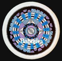 Mandala sobre pieza de madera